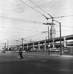 Overhead Lines at Ferry Bus Terminal, San Francisco (1970) Taken to show the layout of the overhead wires for the trolley coach terminal at the Ferry Building, this photo also captures the now demolished Embarcadero Skyway as it stood for decades. via SFMTA Photo Archives