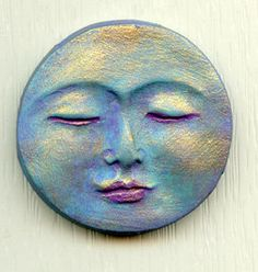 Painted polymer clay peaceful moon face cab. It has been washed with several colors and highlighted with gold metallic. It measures 1 3/8 long x 1 3/8 wide. Flat on the back and undrilled for glue on work. It has been sealed with an acrylic sealer. Great for an Art Doll Face, Assemblage, Altered Art. International buyers I will return any overage you pay for shipping to you.. See my other items too, and thanks for looking