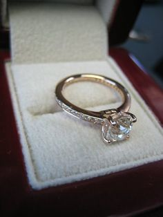 Love this ring, simple, yet elegant. Princess cut looks great. Love the band as well. It's rose gold.