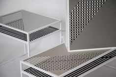 design by STUDIOLAV.  The two perpendicular perforated metal surfaces create an optical illusion