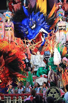 """This is same sereis of previous """"Polo""""'s festival. After the Polo game, 24 big and tall festival flaots are carried through the town as a gorgeous procession. Compared with small drummers, you can see how big the festival float is. That seems as same se """"Rio"""" carnival to me."""