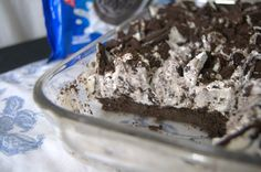 Oreo Cookie Bars - bars made up of an Oreo cookie crust, covered with layers of cream cheese, Cool Whip, Oreo pudding, and crushed Oreo cookies.
