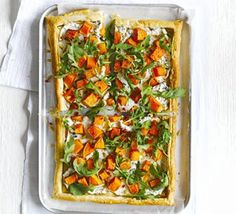 Butternut-ricotta tart with fiery rocket salad: A sheet of ready-rolled puff pastry makes for a simple speedy supper- we top ours with cream cheese, sage, nutmeg and squash. Bbc Good Food Recipes, Vegetarian Recipes, Healthy Recipes, Savoury Recipes, Rocket Salad, Eat Seasonal, Pizza, Ricotta, Family Meals