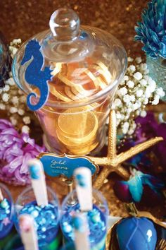 """Apothecary Jar filled with Gold Coins from a Shark & Mermaid """"Under the Sea"""" Joint Birthday Party via Kara's Party Ideas! KarasPartyIdeas.com (32)"""