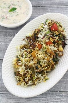 Veg biryani recipe - For making vegetable dum biryani, basmati rice and vegetable gravy are partially cooked separately first. Then both are assembled in the layers with the topping of nuts, fried onions, saffron-yogurt mixture and mint leaves. Then slow cooked on stovetop or in the oven. It is the most popular rice dish from Hyderabad.