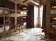 bunk room - I like the curtains here and the window at the end