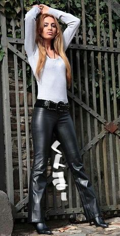 Blonde in belted black hip hugger leather pants and high heel boots