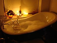 Bubble Bath with Candles | ... the day with a candlelit bubble bath in the cast iron tub accompanied