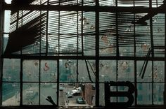 USA. New York City. 1983. A damaged window of a former dock building on Westway. by Thomas Hoepker