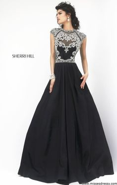 The glitz and glam of this magnificent Sherri Hill 4332. This ravishing evening gown features a scoop neckline with open back design. The fitted bodice with cap sleeves showcases a beaded detail that will give you a glamorous look. Its luxurious full length skirt adds the perfect touch of elegance.