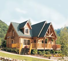 Sitting on the edge of the Great Smoky Mountains, this getaway by Barna Log Homes features a full wrap-around porch and two upper-level balconies for taking in the views. Manufactured with 8-inch round, yellow pine logs with saddle-notch corners, the home has three bedrooms, two baths and total square footage of 1,658 feet. - Cabin Life Magazine - Photo by Barna Log Homes