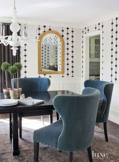 Transitional White Dining Room with Arched Mirror