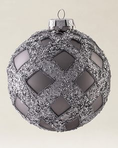 Hand-blown glass ornaments meticulously decorated with beading, glitter accents, and crystals.
