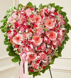 Pink Mixed Flower Heart  This solid heart standing spray is a beautiful symbol of your sympathy and support.