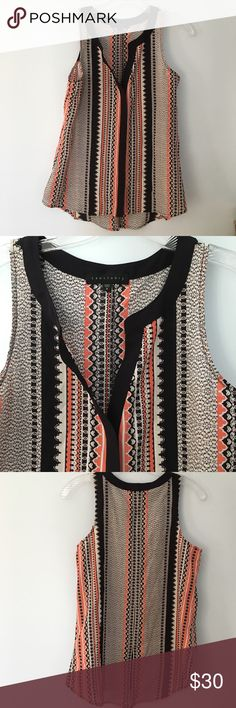 Sanctuary Sleeveless Tribal Print Blouse S Gorgeous silky Sleeveless Blouse with slit opening at neck. Beautiful and fun pattern. Navy blue( reads almost black) , coral and white. High low hem. Size Small. Pls see photos for approx dimensions. Pls feel free to make a reasonable offer! Bundle and auto save 15% on 2+ items in my closet Sanctuary Tops Blouses