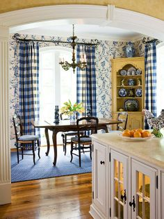 I will always love decorating with blue. Very similar to what I am doing only yellow check curtains