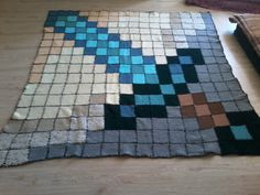 I love Minecraft, so I made a blanket pattern (patchwork-style) based on one of my favourite items in the game, the diamond sword. I knitted and sewed it myself, it is the biggest project I have undertaken all on my own and finished! <3