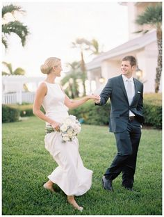 Happy bride and groom photographed at the Boca Bay Pass Club in Boca Grande, FL. Bouquet by Victoria Blooms. Image by Lauren Kinsey.