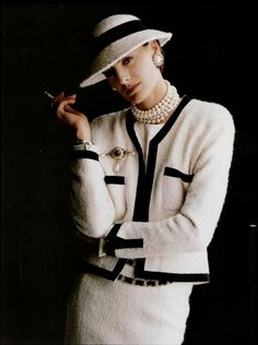 Chanel and pearls.... and also you can see french cuffs shirt with cufflinks <3