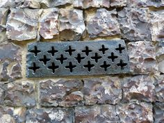 Detail of ironworks in the flint wall of The Bridewell Museum | Norwich, Norfolk