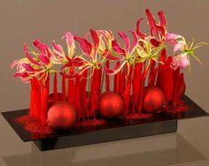 Un centre de table aux couleurs traditionnelles de Noël