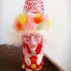 Handmade elf from Tibet. Needlefelted wool creature. Colorful Christmas ornament.