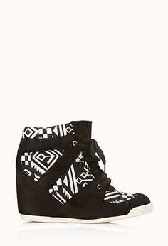 """Wedge sneakers featuring a woven tribal pattern. Faux suede trim. Lace-up top. Round toe. Padded insole. Textured outsole.  DETAILS:  Back heel height: approx. 3.5""""; Shaft height from high point heel: approx. 3.5""""; Platform height: approx. 0.5"""" Upper 1: 100% polyester; upper 2: 68% cotton, 32% rayon; insole 1: 85% cotton, 15% rayon; insole 2: 100% polyurethane; outsole: 100% TPR Imported"""