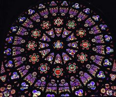The Rose window at the Royal Cathedral of Saint Denis. This is an example of a rosette found in gothic art and architecture, contributing to the idea of height and light. Stained Glass Angel, Faux Stained Glass, Basilica Of St Denis, Mosaic Glass, Glass Art, Renaissance Kunst, Medieval Gothic, Cathedral Basilica, Rose Window
