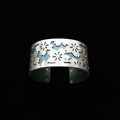 Handmade from sterling silver and anodized aluminum. #ilovegogojewelry #bouquet #cuff