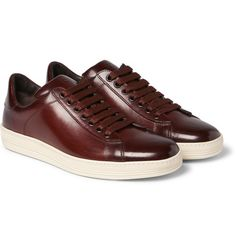 <a href='http://www.mrporter.com/mens/Designers/Tom_Ford'>TOM FORD</a>'s 'Russel' sneakers seamlessly combine sporty elements with casual luxury. Crafted in Italy from smooth brown leather, they're polished by hand to achieve a sleek, lustrous finish. They'll make a fine pairing with soft tailoring or indigo denim.
