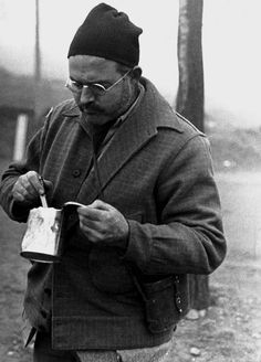 Ernest Hemingway stops for a canned lunch while visiting the front lines; Teruel, Spain, December photo by Robert Capa. Hemingway and Capa were on assignment to report on the Republican attack on the Spanish village of Teruel during the Spanish Civil War. Ernest Hemingway, Liberation Of Paris, First Indochina War, Latest Generation, Magnum Photos, Photojournalism, Japan, American History, Books