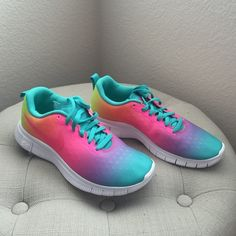 New Rainbow Nike Free 5.0 sneakers New without tags Rainbow Nike Free 5.0 running shoes. Size 6Y, Euro 38.5, equivalent to 8 women's. Gorgeous rainbow color with plastic coating. New, unused and flawless!  Nike Shoes Athletic Shoes