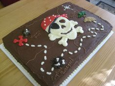Fun pirate-themed treasure map cake for a birthday.