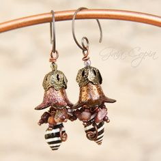 Bead Soup Challenge 2013  Partner~Staci Louise Originals  I used these striped Pyrene shells that Staci sent me to make these fun Zombie earrings. I hand paint and texture lucite flowers and then added tourmaline and amber mop beads around the top of the shells. I love them so much I ordered some of these Pyrene shells to feature in earrings for my shop. The Bead Soup Challenge was SO FUN!