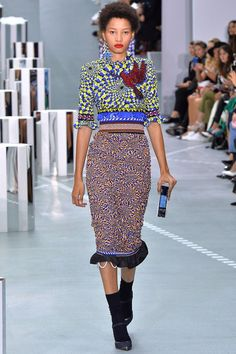 An embrace of her own culture background recontextualises Katrantzou's signatures: her prints, her silhouettes, her heritage. The language is Mary Katrantzou, but the key is Greek. Continuing her e…