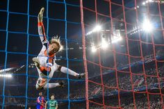 HORIZONTAL: FC Schalke 04's goalkeeper Timo Hildebrand fell after trying to deflect the ball during a Champions League soccer match against ...