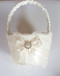 Wedding Flower Girl Basket with Net Lace, Ivory Satin Bow and a Pearl Surrounded by Crystals - The SHANNON Basket. With purple Rose Basket, Flower Girl Basket, Wedding Bouquets, Wedding Flowers, Persian Wedding, Ring Pillows, Pearl And Lace, Rings For Girls, Wedding Crafts