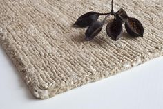 """""""Earth Black"""" is a design rug produced by Nani Marquina and made of New Zealand wood"""