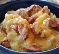 For cold winter nights....Cheese, Potato, & Smoked Sausage Casserole    3 cups idaho potatoes, peeled, boiled and cut into cubes when cool, approx. 1 lb  4 tablespoons butter  4 tablespoons flour  2 cups milk  1/2 teaspoon salt  1/4 teaspoon pepper  1/2 lb Velveeta cheese, diced  1/2 cup sharp cheddar cheese, shredded  1 lb skinless smoked saus