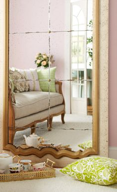 A tall floor mirror makes a room feel larger!