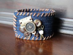 Sew Charmed Denim Cuff Bracelet accented with Vintage and New Buttons with a Snap Closure by AllintheJeans on Etsy