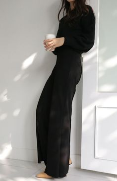 Minimalist style | All-black jumpsuit with blush heels