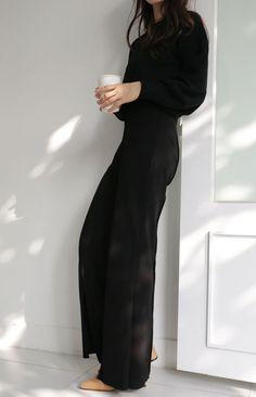 Minimalist style | All-black jumpsuit with blush heels