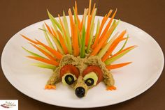 Porcupine Party -  Great way to present crudités.  The body is the dip, hummus.