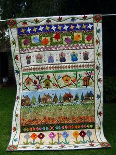 Row Quilt with bird houses
