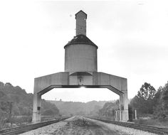 File 1979 - This concrete coaling tower stands over the Norfolk & Western Railway tracks in Vicker, Montgomery County. The tower was built in 1940 and became obsolete with the death of steam railroads in 1958. | Roanoke.com