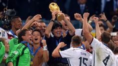 Head coach Joachim Loew of Germany holds the World Cup