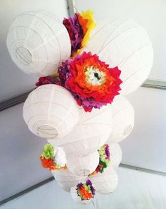 Paper Lantern chandelier with tissue paper flowers accents - so cute!