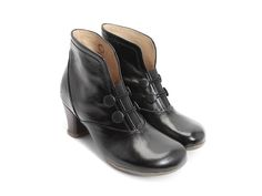 """Already a Fluevog classic, this 2.5"""" heeled bootie with soft Baccarat Patent leathers, soft rubber soles, and a leather wrapped heel has won the hearts of millions of Fluevogers around the world. With a wide toe box, cute buttons, and a comfortable sole, this functional bootie promises to be the love of your life. Your Love Makes Me Sing.Half sizes available.Instagram @fluevog #vog_giulia"""