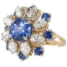 Oscar Heyman Sapphire and Diamond Ring | From a unique collection of vintage cluster rings at http://www.1stdibs.com/jewelry/rings/cluster-rings/